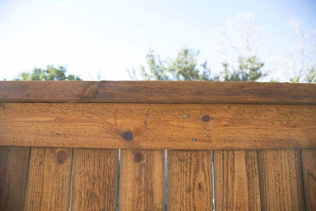 Capped fence, stained, Lubbock, TX