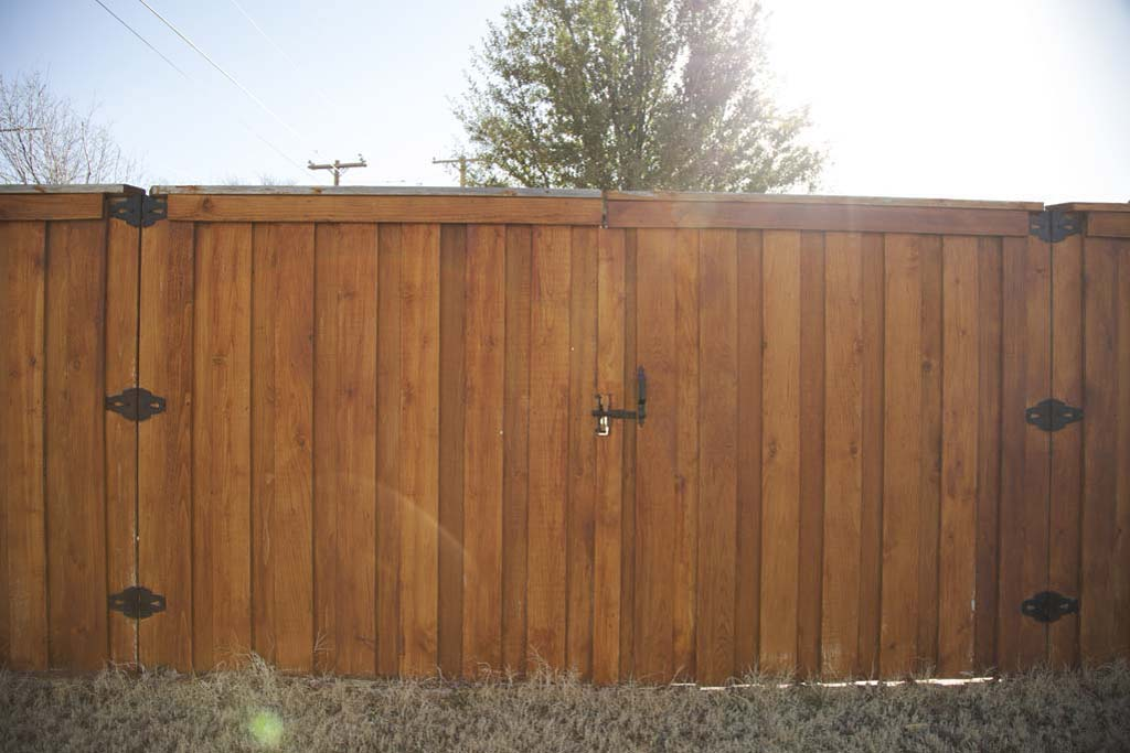 Drive through gate with 6 black hinges