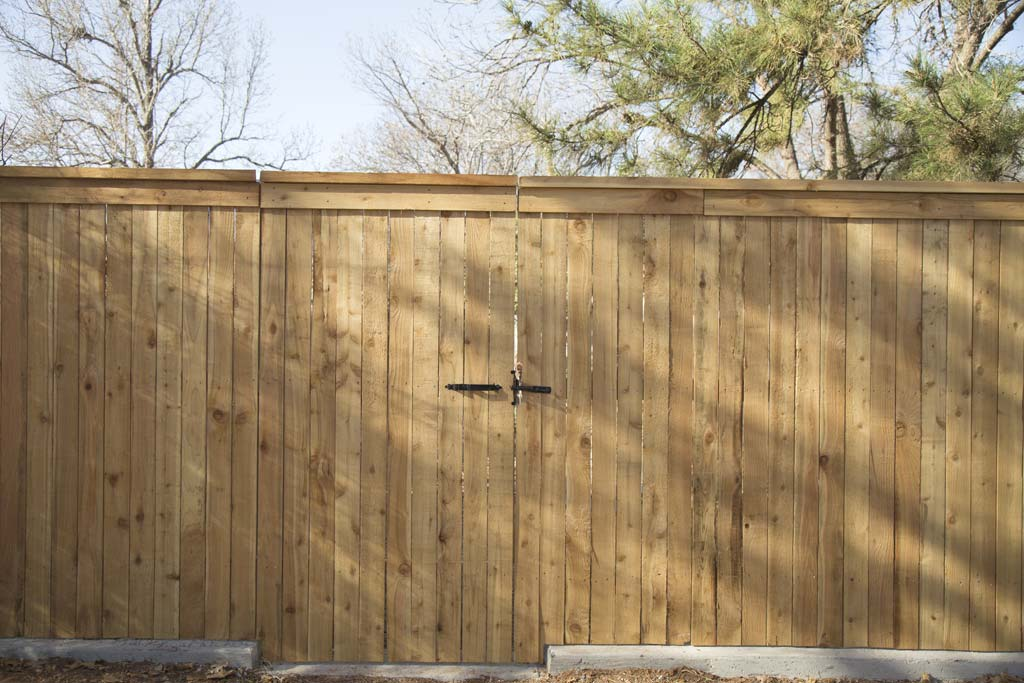 Capped fence, Concrete footer dropped for gate