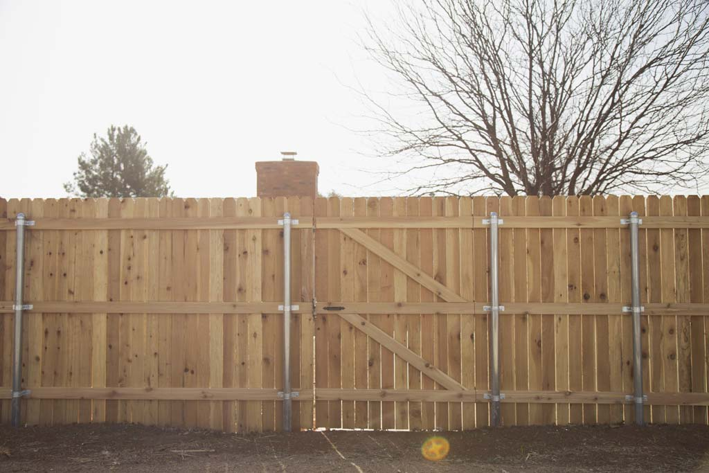 6' tall dogear fence with wood framed gate