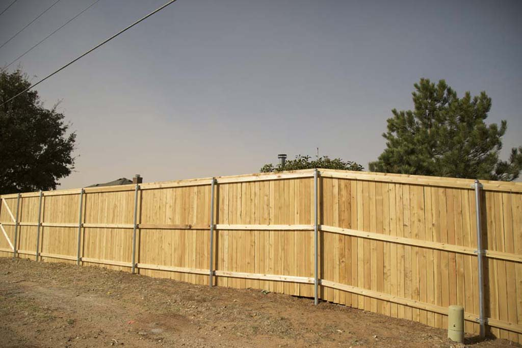 "7' tall capped fence, 4"" wide pickets"