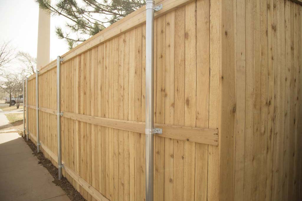 Capped fence with 2x4 Cedar lumber